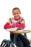 Jeune fille au bureau à l'école sur le blanc photos libres de droits