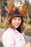 Jeune fille avec des klaxons de diable Photos libres de droits