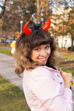 Jeune fille avec des klaxons de diable Photos stock