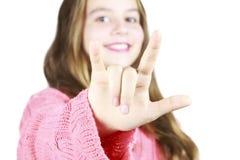 Jeune fille avec la langue des signes Image libre de droits