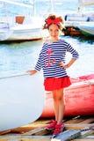 Jeune fille avec le bateau Photo stock
