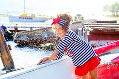 Jeune fille avec le bateau Photographie stock libre de droits