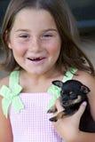 Jeune fille avec le chiot Photographie stock