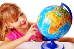 Jeune fille avec le globe Photographie stock libre de droits