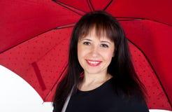 Jeune fille avec le parapluie rouge Photos libres de droits