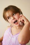 Jeune fille avec le portable Photo libre de droits
