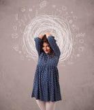 jeune fille avec les lignes et les icônes circulaires abstraites de griffonnage Photographie stock libre de droits