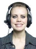 Jeune fille avec un écouteur Photos stock