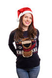 Jeune fille avec un chapeau de Noël d'isolement sur le fond blanc Image stock
