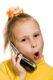 Jeune fille avec une surprise de téléphone portable oh Photos stock