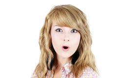 Jeune fille blonde étonnée d'adolescent Image libre de droits