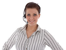 Jeune fille caucasienne travaillant au centre d'attention téléphonique Photographie stock