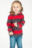 Jeune fille chantant et dansant Photos stock