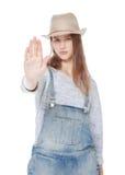 Jeune fille d'adolescent faisant l'arrêt signer d'isolement Foyer sur la paume Images libres de droits