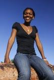 Jeune fille d'Afro-américain sur Canon Image stock