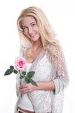 Jeune fille dans l'amour avec une rose Photographie stock