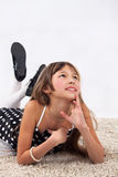 Jeune fille sur le plancher Photographie stock libre de droits