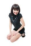 Jeune fille dans le chemisier noir et les circuits photographie stock