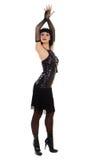 Jeune fille dans peu de robe noire. Photographie stock