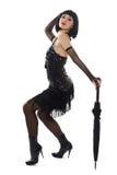 Jeune fille dans peu de robe noire. Photo libre de droits