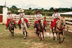 Jeune fille dans un Escaramuza traditionnel Charra Photographie stock libre de droits