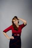 Jeune fille dans une robe rouge Images stock