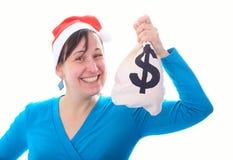 Jeune fille de Santa avec le sac à argent Photographie stock
