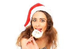 Jeune fille de Santa Claus avec la sucrerie Image stock