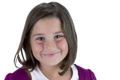 Jeune fille de sourire d'isolement sur le blanc Photographie stock libre de droits