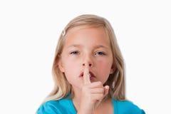 Jeune fille demandant le silence Image stock