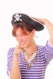 Jeune fille drôle dans le chapeau de pirate Photographie stock