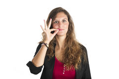 Jeune fille effectuant le geste de silence Photographie stock libre de droits