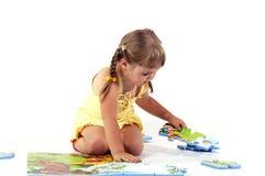 Jeune fille et puzzles Images libres de droits