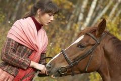 Jeune fille et son cheval Image stock