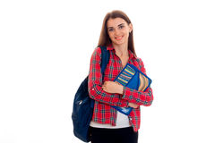 Jeune fille gaie d'étudiant avec la pose de sac à dos d'isolement sur le fond blanc dans le studio photographie stock libre de droits