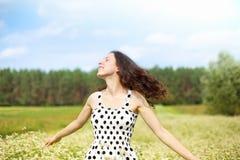 Jeune fille heureuse Photographie stock libre de droits