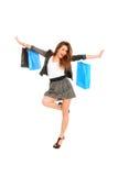 Jeune fille heureuse avec des sacs à provisions Photo stock