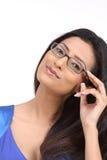 Jeune fille indienne avec des lunettes photos stock