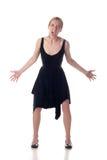 Jeune fille irritée dans une robe noire Photos libres de droits