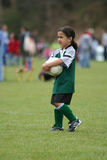 Jeune fille jouant au football Images stock