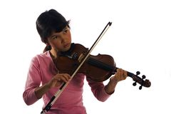 Jeune fille jouant le violon Photo stock