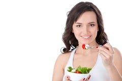 Jeune fille mangeant de la salade fraîche image libre de droits