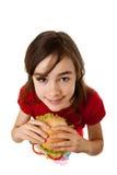 Jeune fille mangeant le sandwich sain Photos libres de droits