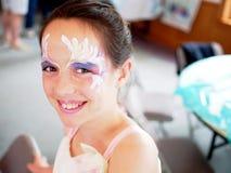 Jeune fille peinte par visage Photos libres de droits