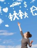 Jeune fille rêvassant avec des nuages de famille et de ménage Photos libres de droits