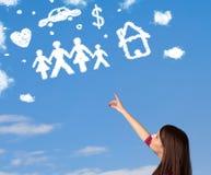 Jeune fille rêvassant avec des nuages de famille et de ménage Image stock
