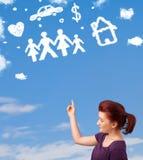 Jeune fille rêvassant avec des nuages de famille et de ménage Images stock
