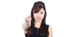 Jeune fille se dirigeant à l'appareil-photo, fond blanc Photos libres de droits