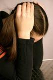 Jeune fille semblant désespérée photographie stock