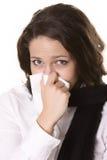 Jeune fille soufflant son nez au tissu Photos stock